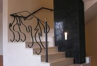 Staircase banister with handrail